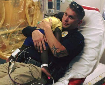 officer_comforts_scared_boy_in_hospital_featured